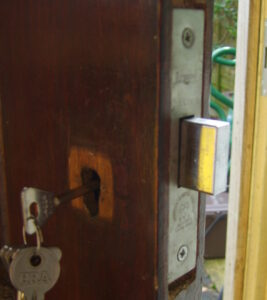 A British Standard Mortice Lock fitted in a wooden door.