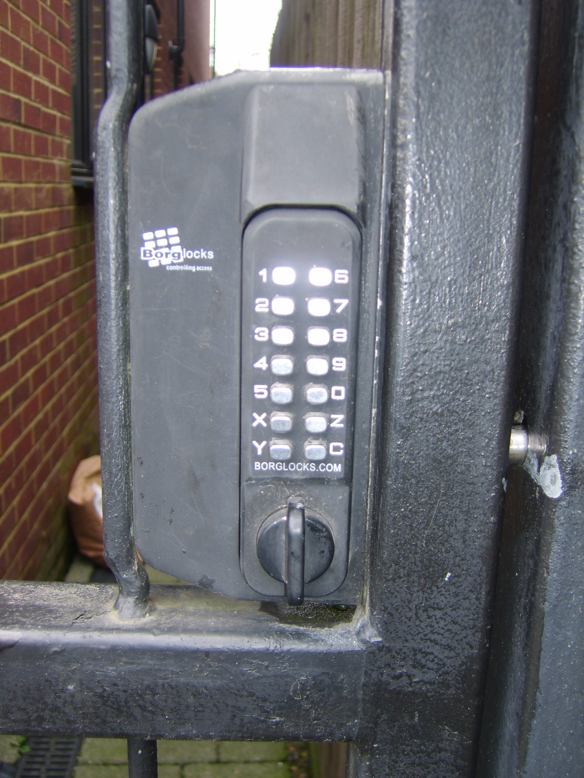 Digital lock on steel gate.