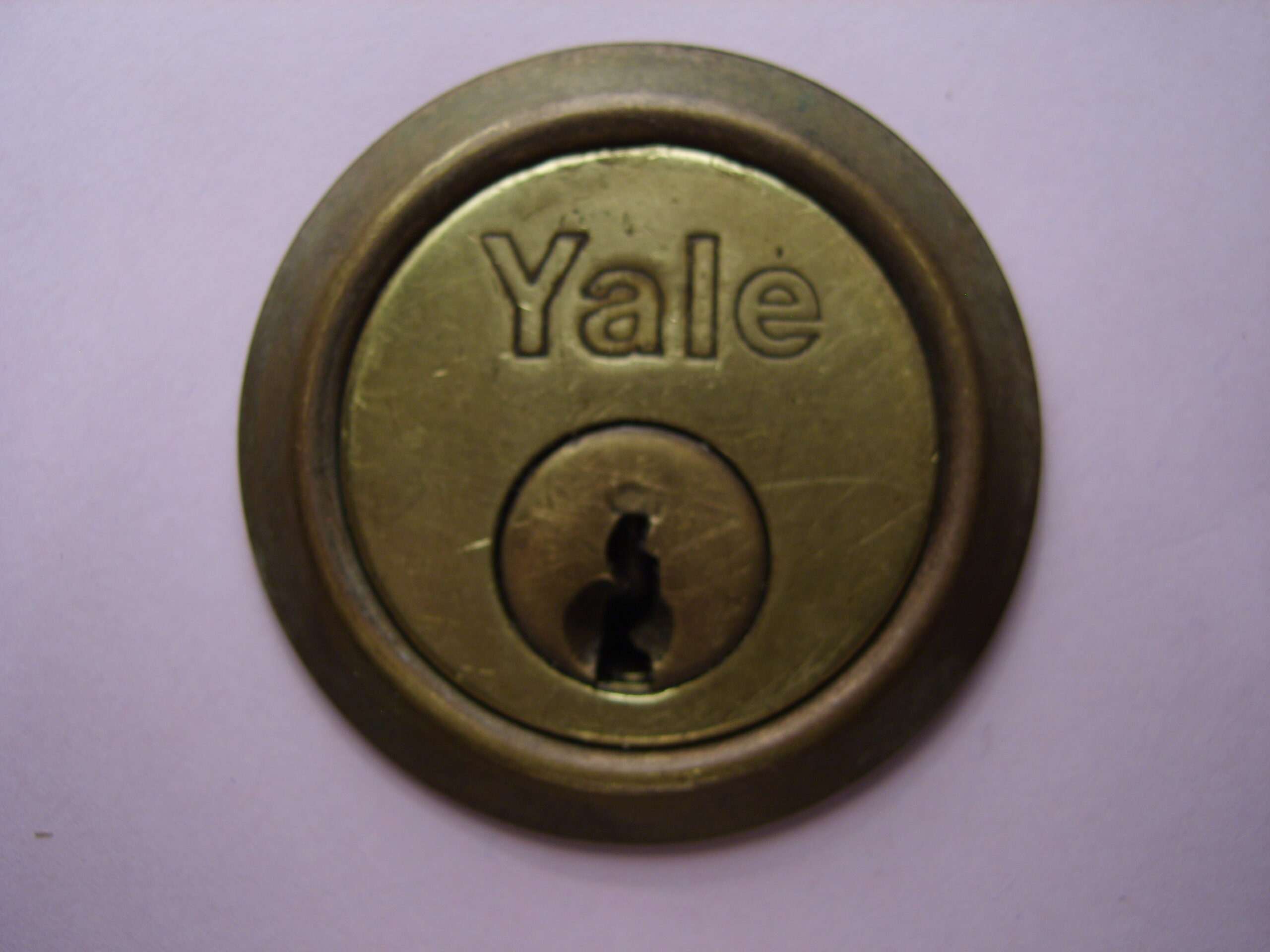 Contact your local locksmith for Yale cylinders